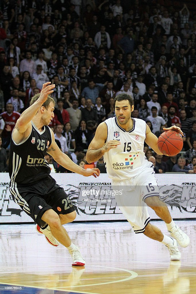 Serhat Cetin of Besiktas Jk Istanbul competes with #25 Anton Gavel of Brose Baskets Bamberg during the 2012-2013 Turkish Airlines Euroleague Regular Season Game Day 7 between Besiktas JK Istanbul v Brose Baskets Bamberg at Abdi Ipekci Arena on November 23, 2012 in Istanbul, Turkey.