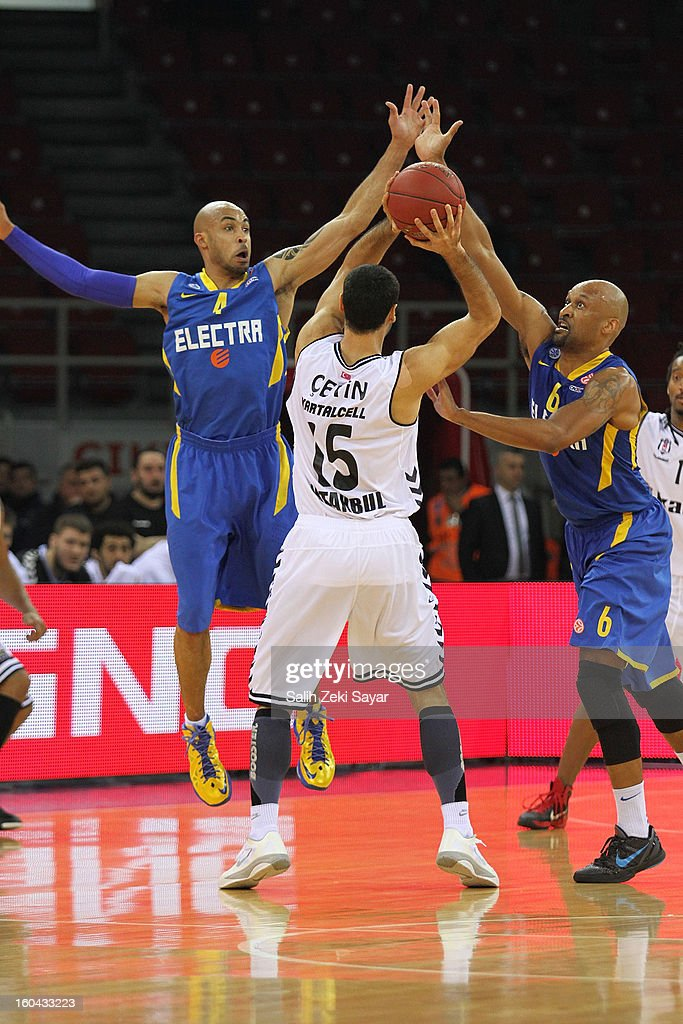 Serhat Cetin #15 of Besiktas Jk Istanbul competes with David Logan #4 and Devin Smith #6 of Maccabi Electra during the 2012-2013 Turkish Airlines Euroleague Top 16 Date 6 between Besiktas JK Istanbul v Maccabi Electra Tel Aviv at Abdi Ipekci Sports Arena on January 31, 2013 in Istanbul, Turkey.