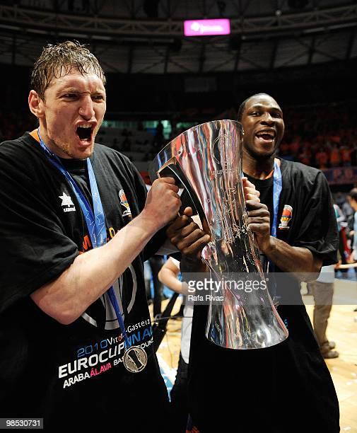 Serhiy Lishchuk and Florent Pietrus of Power Electronics Valencia hold the Eurocup trophy during the Champion Award Ceremony at Fernando Buesa Arena...