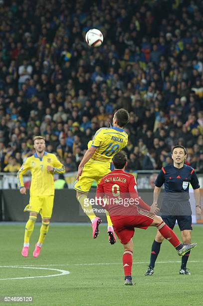 Serhiy Rybalka of Ukraine national team vies with Paco Alc��cer of Spain during the European Qualifiers 2016 match between Ukraine and Spain national...