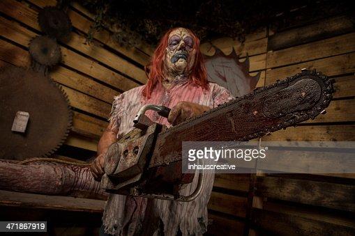 Serial Killer Clown holding chain saw