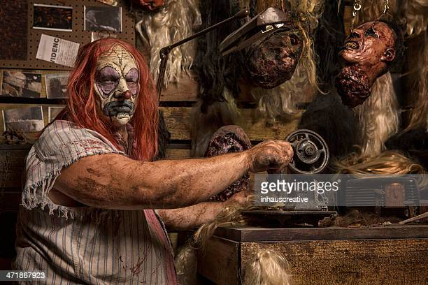 Serial Killer Clown sewing in his cabin