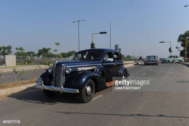 Series 40 Buick Eight car driven by Harsheed Navroz Tarapore is pictured during the Vintage Car Rally in Ahmedabad on November 24 2013 The rally...