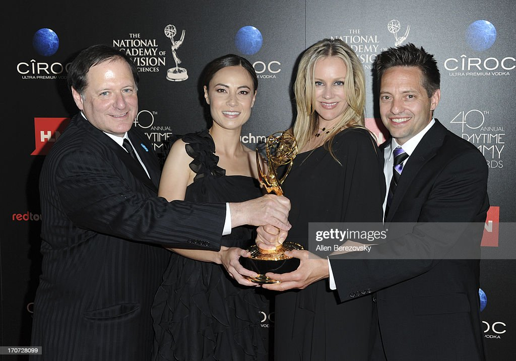 Series creator David Hoffman (L) and co-executive producer Lisa Hockly (2nd from R) pose with the Outstanding Culinary Program award for 'Best Thing I Ever Made' at 40th Annual Daytime Entertaimment Emmy Awards at The Beverly Hilton Hotel on June 16, 2013 in Beverly Hills, California.