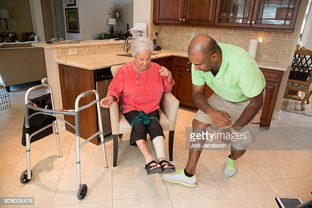 Series: In home physical therapist treating a senior patient