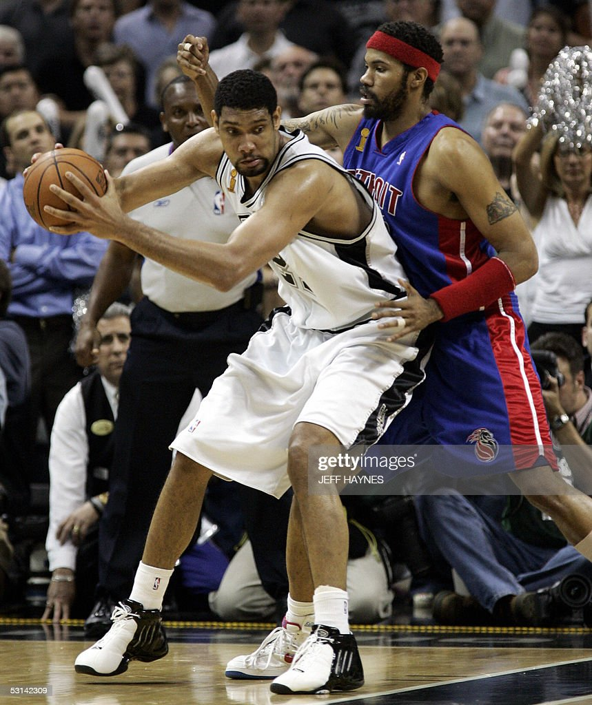 Series MVP Tim Duncan (L) of the San Antonio Spursbacks into Rasheed Wallace (R) of the Detroit Pistons in the NBA Finals game seven 23 June, 2005 at the SBC Center in San Antonio, Texas. The Spurs won the game 81-74 to win the seven game series 4-3.