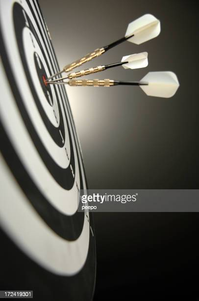 Series of 3 dots hitting the bullseye of a target.