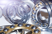 Series ball bearings background with light effect close-up