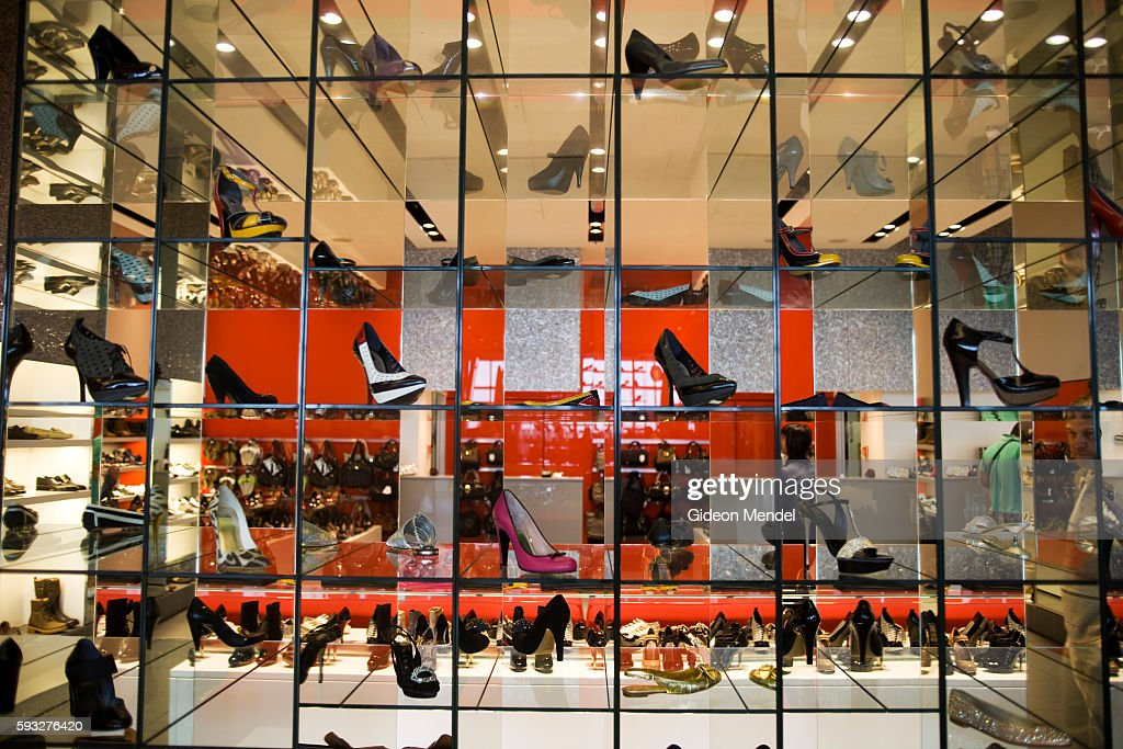 A series of mirrored shelves form a glamorous and striking setting for the mix of elegant shoes at the Kurt Geiger's shoe shop in the duty free...