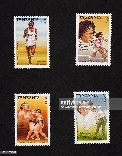 Series of postage stamps honourng famous athletes top from left marathon runner Juma Ikangaa and the tennis player Yannick Noah bottom from left the...