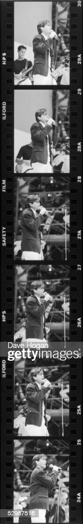 A series of six images of English singer Bryan Ferry performing at the Live Aid charity concert, Wembley Stadium, London, 13th July 1985.