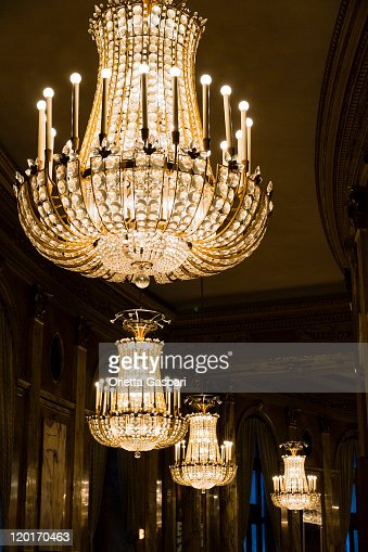 Series of well lit crystal chandeliers