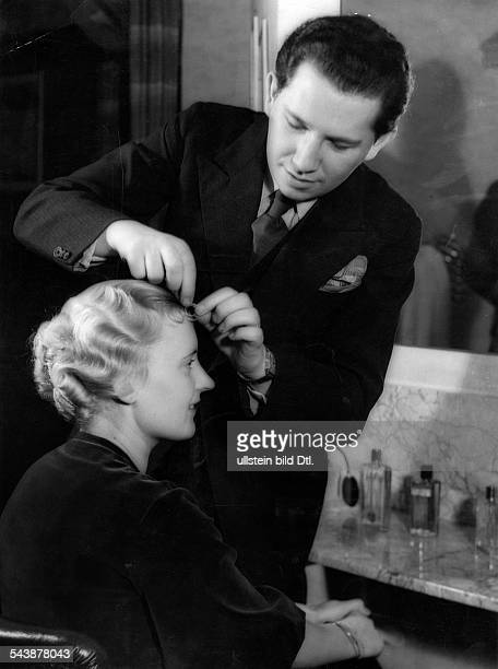 The mystery of the permanent waveFemale customer with perm getting her hair dressed by hairdresser Max Lindemann Photographer Paul Mai 1934Vintage...