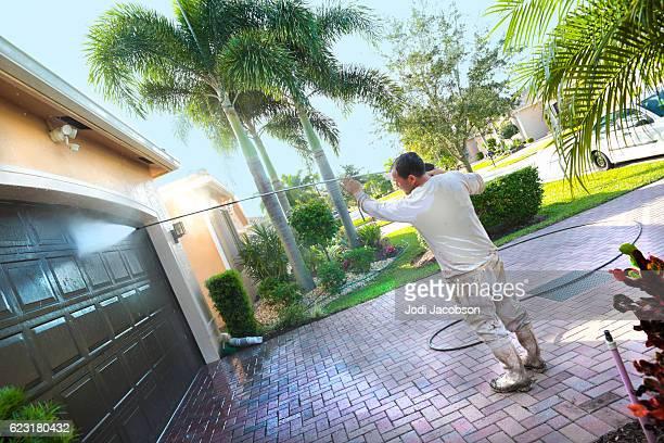 Series:Hispanic Male painter power washing an upscale home