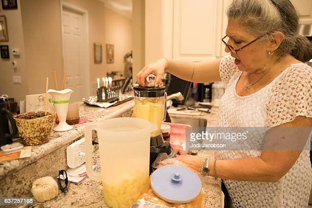 Series:Jewish senior woman making potato latkes for Hanukah