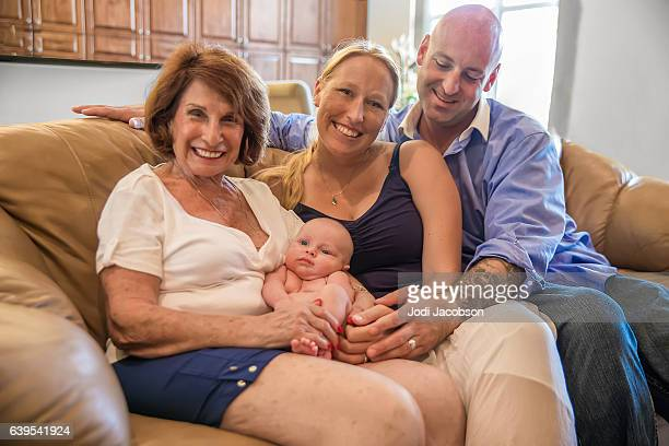 Series:Proud grandmother holds six week old grandson with his parents