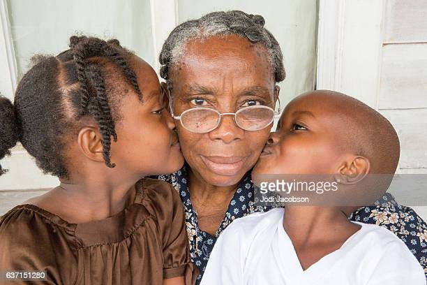 Series:Proud Honduran grandmother getting kiss from grandchildren