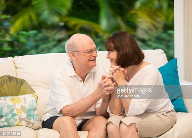 Series:Senior tender moment. Loving couple sitting together. With clipping path