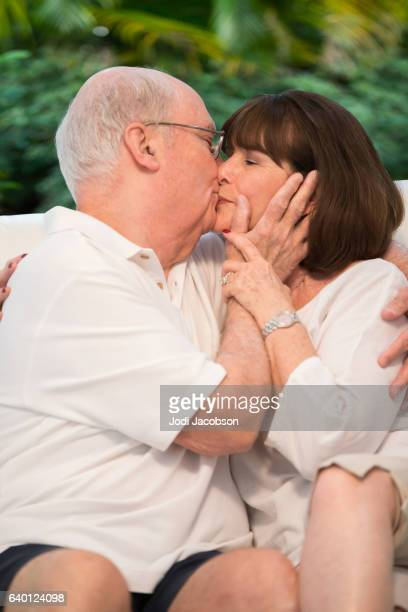 Series:Senior tender moment. Romantic couple kissing. With clipping path