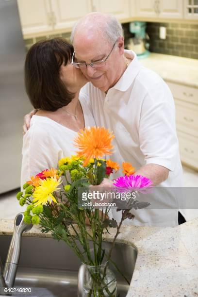 Series:Senior tender moment. Wife thanks husband for giving flowers