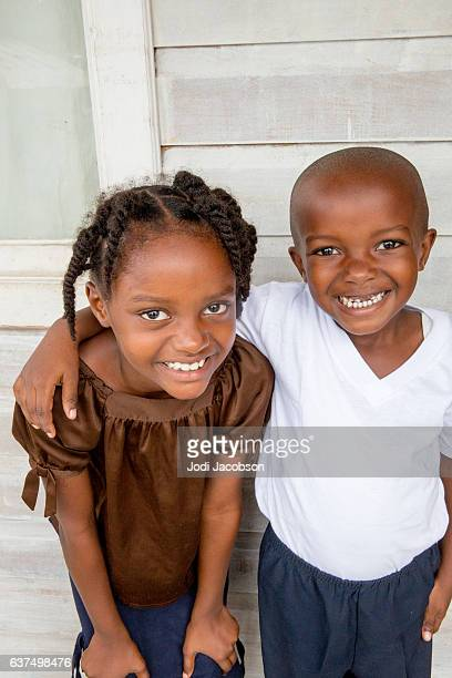 Series:Young Honduran brother and sister on their front porch