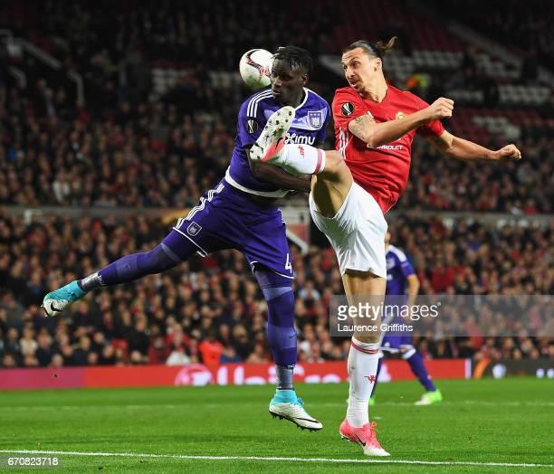 Serigne Mbodji of RSC Anderlecht battles with Zlatan Ibrahimovic of Manchester United during the UEFA Europa League quarter final second leg match...