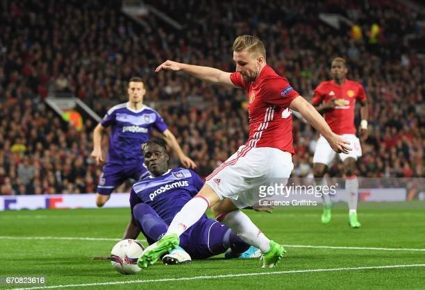 Serigne Mbodji of RSC Anderlecht takes on Luke Shaw of Manchester United during the UEFA Europa League quarter final second leg match between...