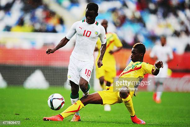 Serigne Niang of Senegal charges over the top of Falaye Sacko of Mali during the FIFA U20 World Cup Third Place Playoff match between Senegal and...