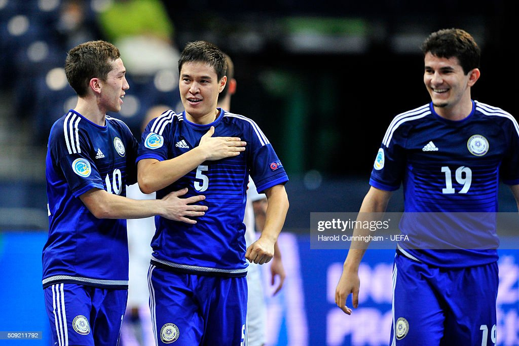 Serik Zhamankulov (C) of Kazakhstan celebrates with his teammates Chingiz Yesenamanov (L) and Douglas Jr. (R) of Kazakhstan second goal during the UEFA Futsal EURO 2016 quarter final match between Kazakhstan and Italy at Arena Belgrade on February 9, 2016 in Belgrade, Serbia.