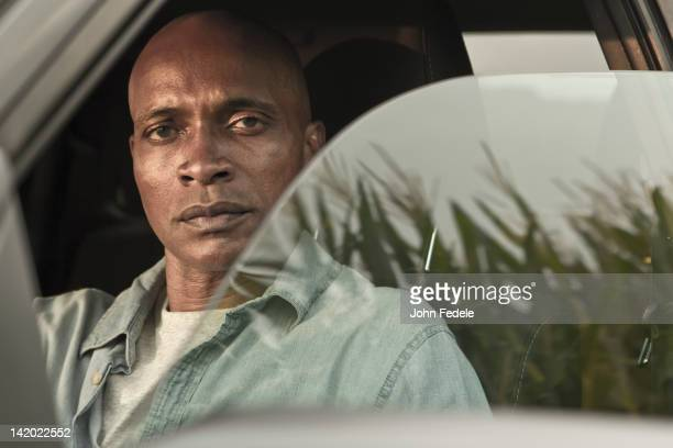 Serious African American man in car