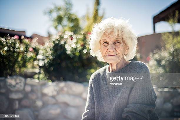 Serious and lonely senior woman outdoors