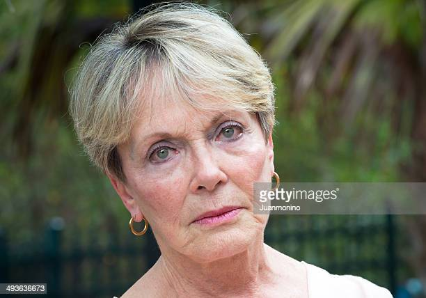 Serious and stoic facial expression on a senior woman's face