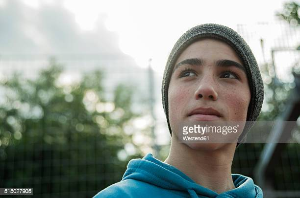 Serious boy wearing beanie outdoors