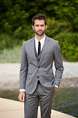 Serious businessman in sharp grey suit, portrait