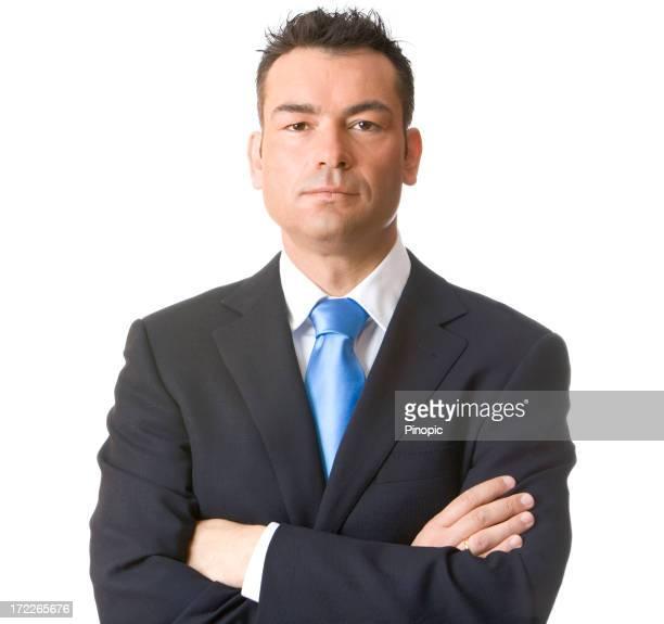自慢のビジネスマンが腕を組む