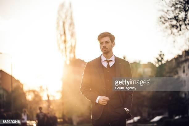 Serious businessman taking a walk