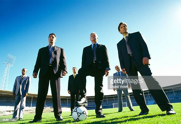 Serious Businessmen Playing Soccer
