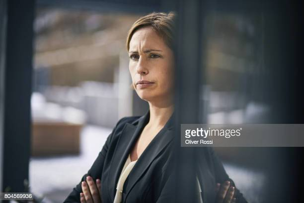 Serious businesswoman at the window