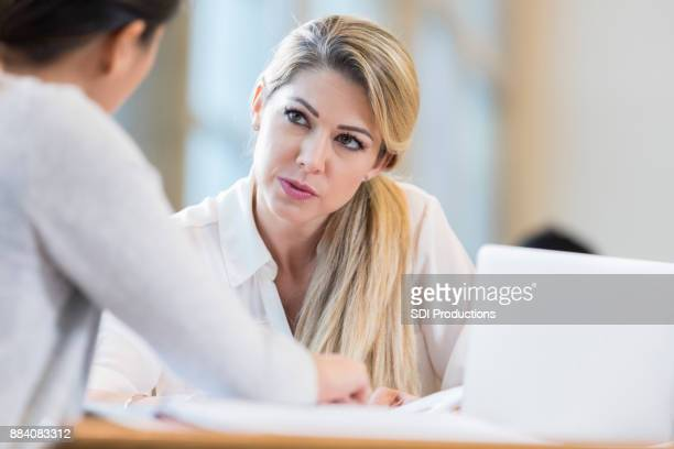 Serious businesswoman meets with female colleague