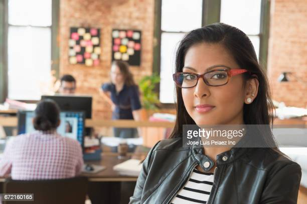 Serious businesswoman posing in office