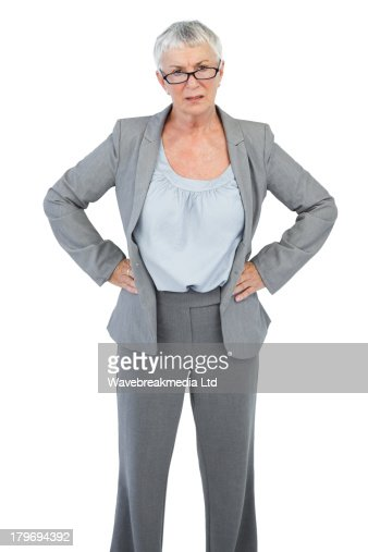 Serious businesswoman with her hands on hips : Stock Photo