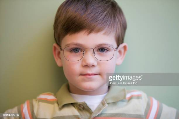 Serious Caucasian boy in eyeglasses