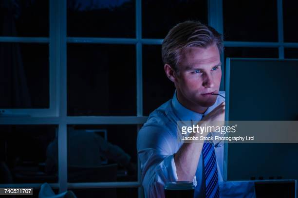 Serious Caucasian businessman using computer