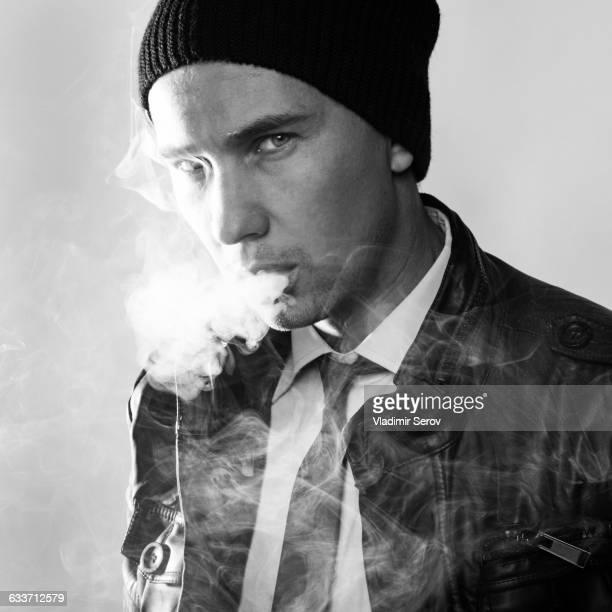 Serious Caucasian man smoking