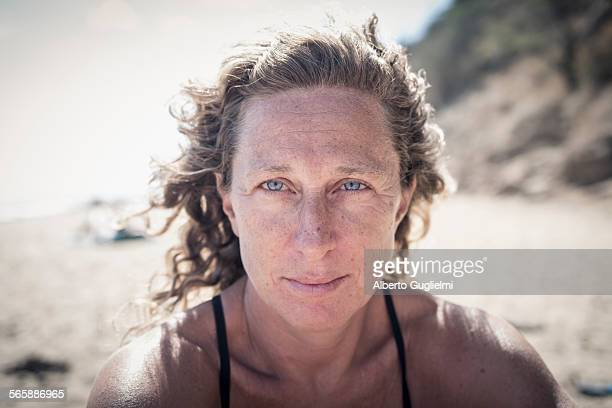 Serious Caucasian woman on beach