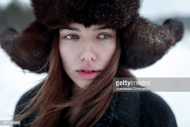 Serious Caucasian woman wearing fur hat and coat in winter