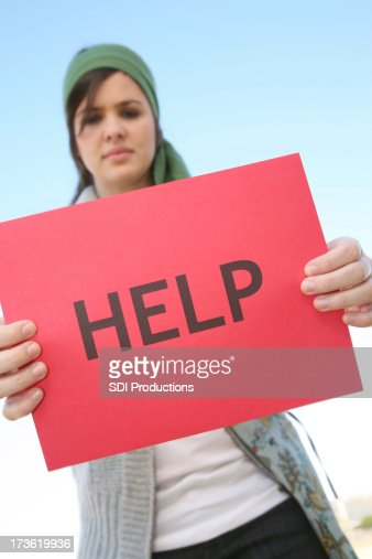 Serious Concerned Girl Holding A Help Sign