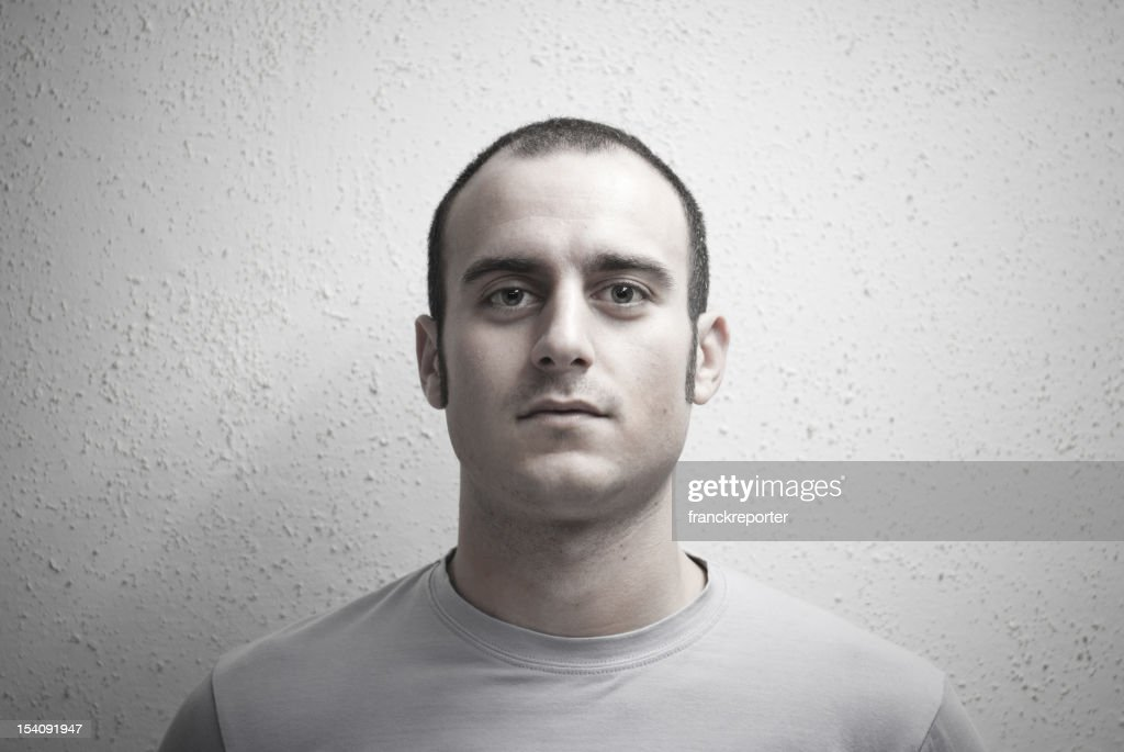 Serious expression of real man : Stock Photo