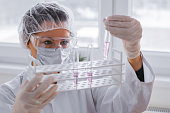 Serious female chemist working in laboratory