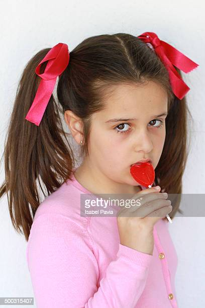 Serious girl eating a lollipop